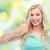 happy woman or teenage girl showing thumbs up stock photo © dolgachov