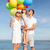 happy family with colorful balloons at seaside stock photo © dolgachov