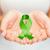 hands holding green awareness ribbon stock photo © dolgachov