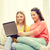 two smiling teenage girls with laptop at home stock photo © dolgachov
