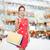 gülümseyen · kadın · elbise · alışveriş · satış · hediyeler - stok fotoğraf © dolgachov