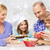 happy family with two kids making salad at home stock photo © dolgachov