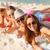 группа · улыбаясь · женщины · смартфон · пляж · Летние · каникулы - Сток-фото © dolgachov