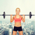 smiling sporty woman exercising with barbell stock photo © dolgachov