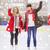 happy girls friends waving hands on skating rink stock photo © dolgachov
