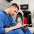 auto mechanic man with clipboard at car workshop stock photo © dolgachov