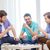 happy three male friends playing poker at home stock photo © dolgachov