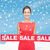 smiling young woman in dress with red sale sign stock photo © dolgachov