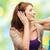 two happy girls with headphones listening to music stock photo © dolgachov