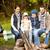 boldog · család · ül · pad · tábor · tűz · kempingezés - stock fotó © dolgachov