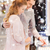 happy couple choosing engagement ring in mall stock photo © dolgachov