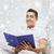 derűs · férfi · ül · kanapé · olvas · könyv - stock fotó © dolgachov