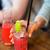 vrouwelijke · hand · cocktail · gedeeltelijk · zichtbaar - stockfoto © dolgachov