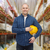 happy man with hardhat over warehouse stock photo © dolgachov