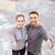 smiling couple showing thumbs up on city street stock photo © dolgachov