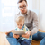 father and son with tablet pc playing at home stock photo © dolgachov