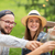 happy friends clinking glasses at summer garden stock photo © dolgachov