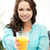 woman holding glass of orange juice stock photo © dolgachov