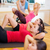 group of smiling women doing sit ups in the gym stock photo © dolgachov