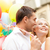 happy couple with colorful balloons stock photo © dolgachov