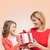 smiling mother and daughter with gift box stock photo © dolgachov