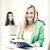 uśmiechnięty · młodych · student · egzamin · papieru · pióro - zdjęcia stock © dolgachov