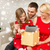 smiling family taking tablet pc out from gift box stock photo © dolgachov
