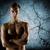 young male bodybuilder with bare muscular torso stock photo © dolgachov