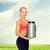 sorridente · mulher · proteína · tremer · garrafa - foto stock © dolgachov
