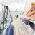 close up of friends legs sitting on yacht deck stock photo © dolgachov