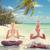 boldog · pár · meditál · lótusz · póz · tengerpart - stock fotó © dolgachov