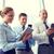gens · d'affaires · smartphones · affaires · travail · d'équipe · personnes - photo stock © dolgachov