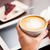 close up of hands with coffee tablet pc and cake stock photo © dolgachov