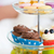 close up of cake stand with cupcakes and cookies stock photo © dolgachov