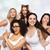 group of happy women in white underwear having fun stock photo © dolgachov
