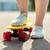 close up of female feet riding short skateboard stock photo © dolgachov