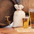 close up of beer barrel glasses and bag with malt stock photo © dolgachov