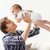 happy young father playing with baby at home stock photo © dolgachov