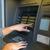 close up of hands choosing option on atm machine stock photo © dolgachov