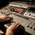 man using mixing console in music recording studio stock photo © dolgachov