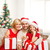 smiling family holding gift boxes and sparkles stock photo © dolgachov