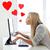 woman sending kisses with computer monitor stock photo © dolgachov