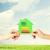 kezek · tart · zöld · papír · ház · energia - stock fotó © dolgachov