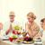 smiling family having holiday dinner at home stock photo © dolgachov