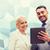 mosolyog · üzletemberek · táblagép · kint · üzlet · együttműködés - stock fotó © dolgachov