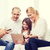 parents and girl with tablet pc and credit card stock photo © dolgachov