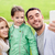 happy family taking selfie by smartphone outdoors stock photo © dolgachov