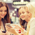 happy women with smartphones and tablet pc in mall stock photo © dolgachov
