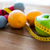 close up of dumbbell fruits and measuring tape stock photo © dolgachov