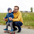 happy father and little son on skateboard stock photo © dolgachov